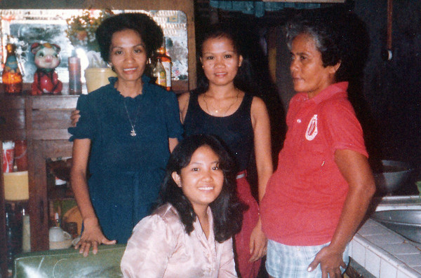 """<center> <font face=""""Myriad Pro""""><font size=""""+2""""><font color=""""66FFFF"""">My Mother (pictured standing, center) with a few relatives. </font></font size></center>"""