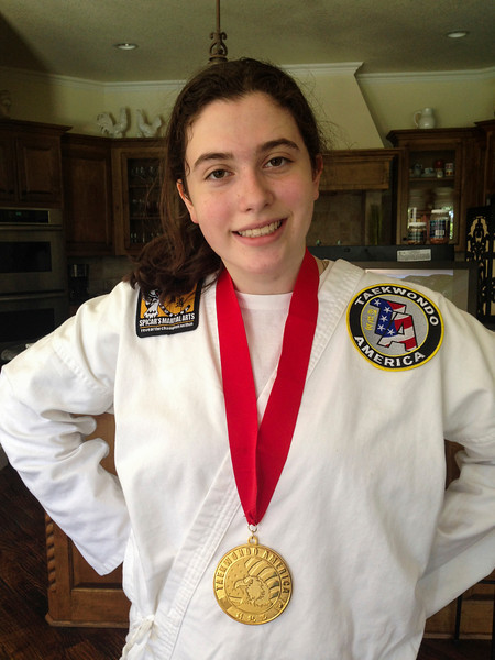 Following Regional Tae Kwon Do Tournament, Southlake, Texas (gold medal in sparring, black-belt level)