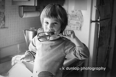 "11.22.13 = Flashback Friday - Baking moments  I love this black & white shot my dad captured of my sister. This was one of our favorite things to do when we were kid's, was licking the beater.  With four girls, someone was always taking cookies or cupcakes to some event.  We used to pull the kitchen chairs up to the counter to watch my mom while she was cooking and baking.  I remember her letting me crack an egg and help measure.  Maybe that's why I love cooking and baking to this day.  And I still love to lick the beater!    ""I come from a family where gravy is considered a beverage."" Erma Bombeck"