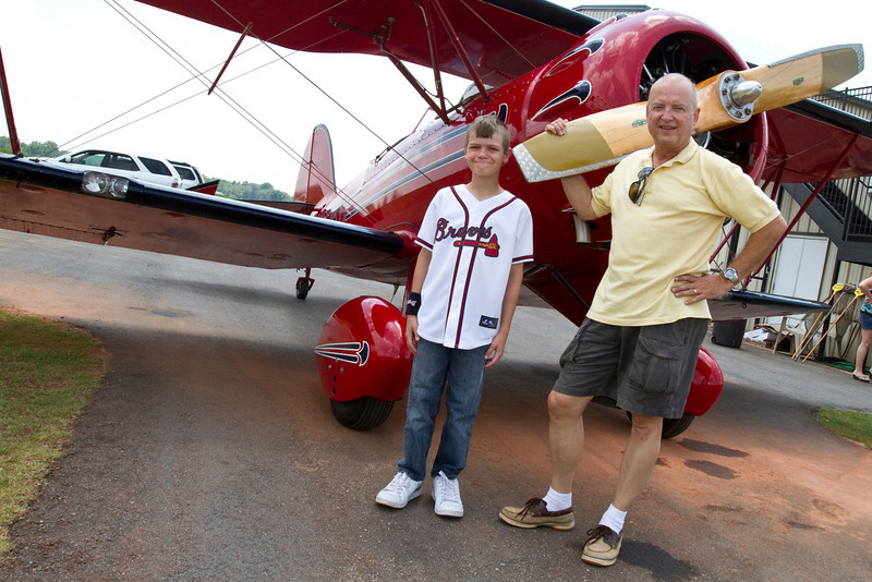 As part of Ira's 10th birthday celebration, we TOTALLY surprised him with a flight in an open cockpit bi-plane at Peach State Aero in Williamson, GA. David, the pilot, took Ira up for about 15 minutes.