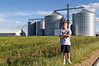 Ira in front of grain silos, near my good friend Doug Hermsen's dairy farm in Colesburg, Iowa. <br /> <br /> We spent the day and night with Doug, with Ira getting to see where milk REALLY comes from. <br /> <br /> Thanks, Doug, for having us up. I don't think either of us will ever forget this trip!!