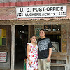 The obligatory tourist picture on the front porch of the old Luckenbach Post Office/General Store.<br /> <br /> When Rueben and Cynthia came to visit for the weekend what better way to enjoy our time together than a hot August Saturday afternoon doing the tourist thing in Luckenbach?  This has been an exceptionally hot summer with temps reaching 100+ daily so there just weren't a lot of afternoon outdoor choices not involving water/swimming.  Luckenbach has some wonderful shade trees that help keep things reasonable.  That and the fact that neither had been to Luckenbach before sealed the deal.  After a detour for some tortilla soup at Jim's Restaurant in Oak Hill, we headed out from Austin, casually making our way west with Luckenbach as our destination.