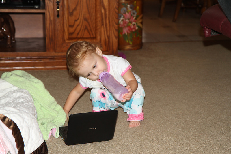 Avery marveling her new DVD player while getting ready for bed.