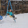 She wanted to get out in the snow so badly but since her boots were in the car she wore MY sneakers out to swing in the back yard!