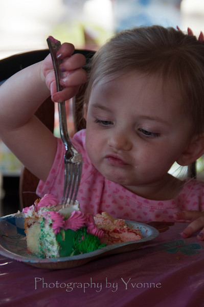 Devyn's getting into the birthday cake!