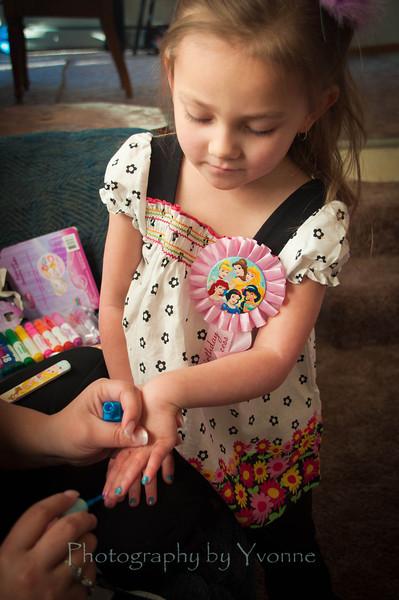 Birthday girl having Mommy polish her fingernails!