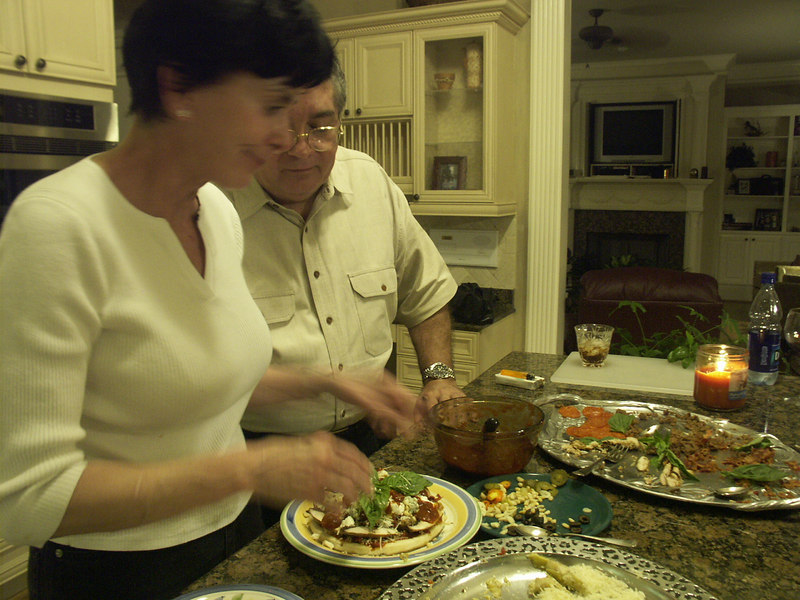 My dad helps Diane make a pizza