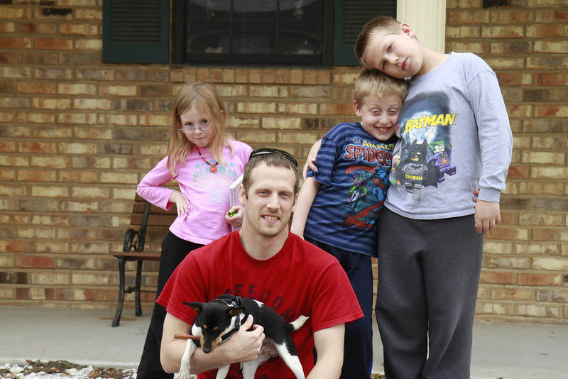 Stormy, Jakob, and Andrew flank their dad, Jason and Buddy the Grand Dog.