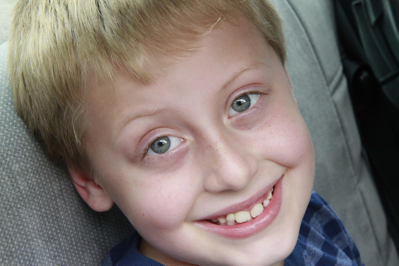 Jakob's all smiles as he departs on a road trip to Illinois... to do home work :-O