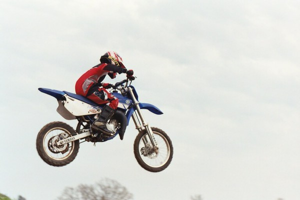 Jumping his YZ100 at Cross Creek Cycle Park