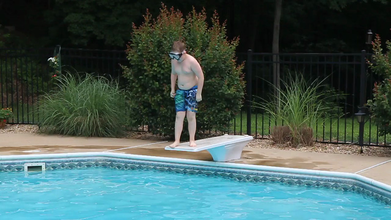 Beginning of the season and he won't jump or dive into the pool.  Compare this to the month of July were you won't be able to keep him off of the board :-)