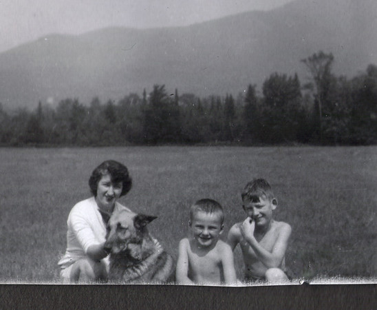 Ma (our mother, Maxine June King, maiden name McLean (1927-2010), Ricky (1948-1963), Me (Robert King Jr.(1948-     ) and my brother Bruce McClean King (1946-     ), in front of the backdrop of Mt. Abraham, Salem, Maine about 1952.  I am sure that Dad (Robert Lee King Sr. (1926-2008) took this picture.   I am so grateful for the images that my Father and his Father took.  These are little glimpses of the family history that become so valuable as the decades passed and with the advent of the internet they become an archive of the family.  They could not have imagined what they started by picking up those cameras back then.     My Grandparents (Dad's parents) owned the log cabin on the Lovejoy Road, just up from Rte 142 and on the left as you mount the first knoll.   As a teenager I twice climbed to the very top of Abraham on sudden notions, once I remember with Gramp's black and tan hound, Sammy.  It was not with Ricky; for Ricky passed when I and the dog were 15 years of age and that was one of the saddest days of my life and still is.  On one of those trips up the mountain, Sammy took off after a deer and I was concerned that I had lost him.   Once it started there was no turning Sammy back.  It happened near the base of the mountain, just at the toe of the slopes, in a small, open pocket, just above Clark's Field, off the end of the Lovejoy Road and to the left.  It was the first time I experienced just how inconspicuous a deer can be while being right in the open.  That deer was bedded in moss, right in the open and it stayed frozen in that moss bed, literally right up until my next step was going to be put right on top of it.   Sammy was right next to me but neither of us detected that deer until the instant it jumped off the moss bed and took off......with Sammy in pursuit and wailing away.   As I recollect that day, Sammy and I never saw each other again that morning. He was back at the cabin when I got back.   It seemed to me that when I was at the top of Mt. 
