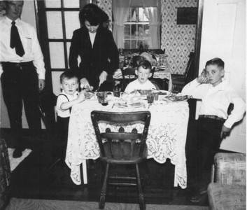 Norman Rockwell could have used this one.      Left to right:  Dad (Robert Sr.), me (Robert Jr.), Ma (Maxine King), Bruce (my brother), David King (my uncle).  Image taken on Thanksgiving at 35 Rosedale Street, about 1950.