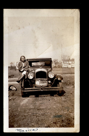 "Our paternal Grandmother (Beda Belle King, 1908- March 23, 1986), on the fender of a 1928 Chrysler Model 62 at what I believe to be the new Rosedale Street, Portland, Maine....circa 1934.  It was about that time that Gram and Gramp (as we called them), had a house built at 35 Rosedale street.    The folks at the Antique Automobile Club of America identified  the car.  Later, I verified their accuracy  by entering the make, model and year at  ""Google Images"".  Thanks to AACA.com and Google.  Reference that ""Tydol"" sign in the car's radiator:  In the 1920's, the Tidewater Oil Company sold motor oil in eastern America under the brand name of Tydol.  As an afterthought, for those who do not know, I should explain why the piece of sign is there in the first place:  That large, rectangular black surface is the radiator.  In cold weather, anything flat, such as a piece of cardboard,  placed over a section of the vehicle's radiator will decrease the air flowing through to the radiator baffles and thus decrease the cooling.  In the end, it is there to increase the engine's temperature,  probably so that the people can get more heat to the vehicle's interior.    http://en.wikipedia.org/wiki/Tidewater_Petroleum  Grammy was adopted and raised by the Passmores, who owned a dairy farm, directly across Auburn Street from the now Shaw's North gate shopping center, Portland, Maine.   If you're from Portland you never knew there was once a dairy farm there did you?  It was there from the 1800's and into the 1930's.  And last, I should mention that I do not know the name or ownership of the dog on the right margin, as I do not recall the family mentioning a dog of that description.  Update:  the dog's name is Cookie  Elders are full of fascinating information.  But few of us in our high tech societies refer to them.  In the less-than-high-tech societies the Elders make sure that ALL information is passed down to subsequent generations.     I now regret not having talked at much greater length with my Elders regarding the way things were.  It is sad......because now it is too late and maybe that is why I now try to pass on as much information as I can."