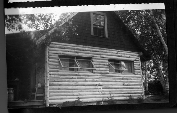 This is the addition to the original one-room, log cabin.  Note the stainless steel Hood's milk container in the lower left corner of the image.  We used those to transport water from Portland to Salem.  Later, my Grandfather hand-dug a small well down in the woods about 200 yards below the camp, at a very small vein of water coming from the side of a slope.  He enclosed the new pool with a cement basin and covered it with a roof.  It provided a modest amount of water but we still had to lug the water up to the camp.  My Grandfather talked about having a deep well dug on the land and made several inquiries over several years.   I watched as he even used a dowsing stick to look for water.  In the end, my Grandfather did not live long enough to have the well dug and so he did not achieve running water in the camp.  As I look back at the years I had with them here, I would have had another full decade with them here, had I not gotten involved with a woman and gotten  married.  And the marriage ended in a divorce that I did not want.  I should never have gotten married to her in the first place.   That is a truth that I do not mind stating publicly.   My time with my Grandparents was so good for me.  We just enjoyed each other's company.  I had to ruin it because of my hormones.    And as I think about it now, I am sure that they missed my company at camp.....but they never were selfish enough to express that.  I miss them.