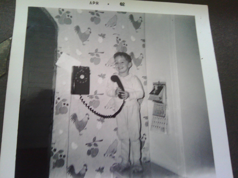 David on the phone on Mercer Street, Decatur in 1962.