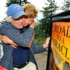 "Marni Morrison gives her dad, Mark Shaw a  hug after Mark received a Father's Day present, a framed photo of the cover of his book.<br /> Mark Shaw will celebrate Father's Day this year with his newly discovered daughter, Marni Morrison, and her family in Boulder.  The family had a picnic on Flagstaff Mountain. For  more photos and a video of the picnic, go to  <a href=""http://www.dailycamera.com"">http://www.dailycamera.com</a>.<br /> Cliff Grassmick / June 17, 2011"