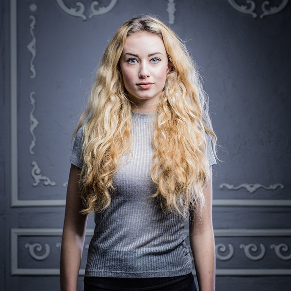 Curly blonde and stuccoed vintage background