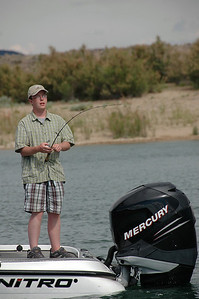Chris Matern (18) of West Jordan as he fishes Flaming Gorge Reservoir.  Chris won this fishing experience by being a youth essay contest winner in 2006.  By Utah Division of Wildlife Reources