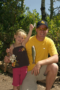 Young girl with a nice fish she caught poses with her father.  Photo taken 8-7-09, courtesy of Utah Division of Wildlife Resources