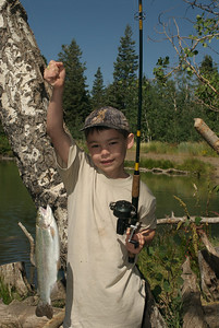 Youth showing off a very fine catch.  Photo taken 8-7-09, courtesy of Utah Division of Wildlife Resources.