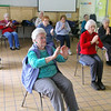 Many seniors do some yoga with the Silversneakers program at the YMCA in Fitchburg on Wednesday morning. SENTINEL & ENTERPRISE/JOHN LOVE