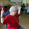Peg Scriven, 81, does some yoga with the Silversneakers program at the YMCA in Fitchburg on Wednesday morning. SENTINEL & ENTERPRISE/JOHN LOVE