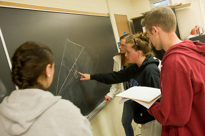 Westfield State students work through a problem in professor Fleron's  class.