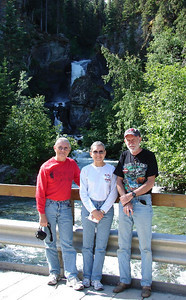 7/1/06 - Verne and Bonnie Hauck, with friend Chuck Williamson, standing in front of Liberty Falls as they toured Alaska.