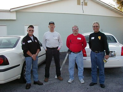 Four survivors of the '02 Rendezvous, only two of whom actually rode in it.  From left to right - Verne Hauck (who went on to ride his H-D over 100,000 miles that year), meself, Art Garvin (who really can ride, when he takes his Gold Wing off its trailer), and John Langan, the winner of the event.