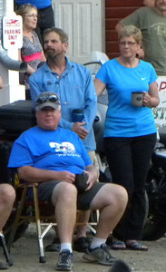 June 22, 2012:  Kevin (seated) and his lovely and talented wife Annie watching the bike games at D2D in Dawson City, Yukon.