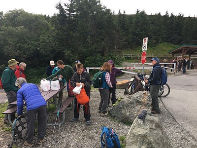 Our group totals 15 - now collecting our lunch bags at the trailhead.