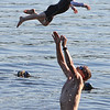 Features at Westford town beach at Forge Pond. Scott Brooks of Westford plays with his son Cameron, 5. (SUN/Julia Malakie)