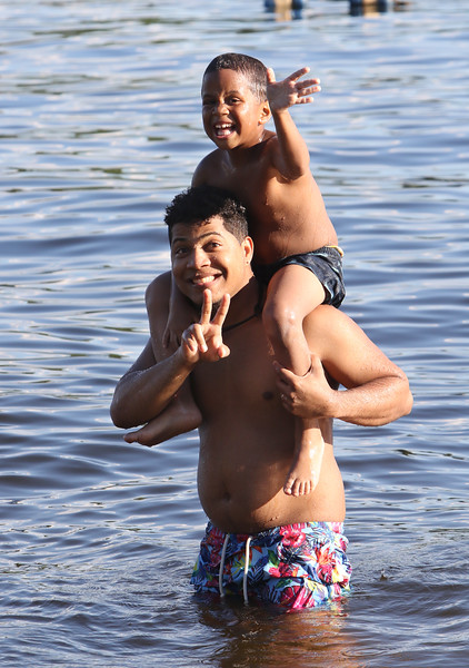 Features at Westford town beach at Forge Pond. Antonio Valenzuela and his son Jayden Valenzuela, 5, of Lowell, cool off. (SUN/Julia Malakie)