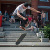 AJ Pelletier of Lunenburg competes in the Frankie Fortuna Skate Challenge held on Townsend St outside the Acid Reign skate shop. Friends of Frankie Fortina sit and watch form the steps of the old East St School. SENTINEL&ENTERPRISE/ Jim Marabello