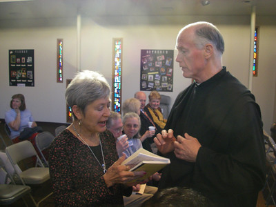 Marilyn Wright engaging Fr. Wright.