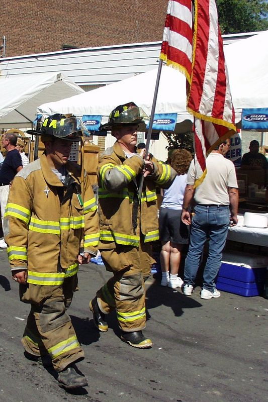During a parade for General Montgomery Day in Montgomery, NY, I caught these two heroes marching with their unit.  This picture was taken on September 9, 2002, almost 1 year to the day after the World Trade Center tragedy.  These two guys were there on 9/11, and survived.  Many of their fellow firefighters (343 in all) did not.