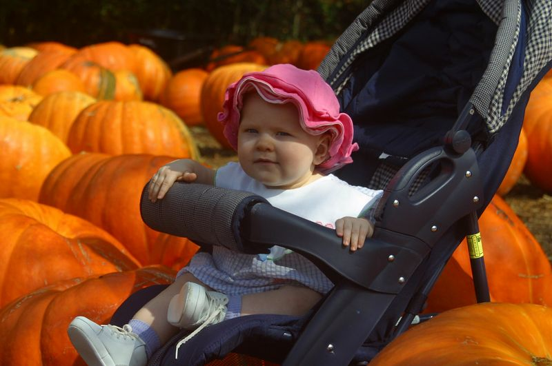 Elaina picks out her pumpkin at Burt's Pumpkin Patch in Dawsonville, Ga, in October, 2004.