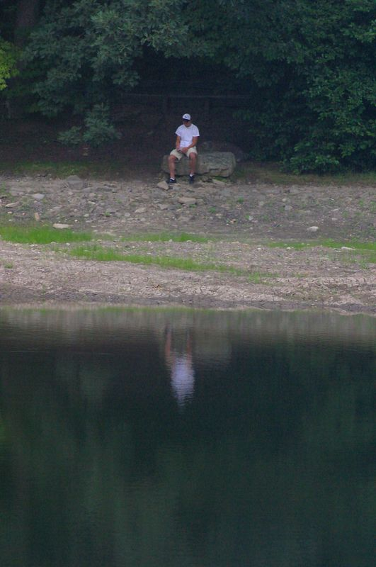 It looks like this guy is contemplating the meaning of life while he sits on a rock next to Lake Susan, at Montreat College in Montreat, NC.  Actually, he's listening to his iPod!  But I like the shot with his reflection in the water.