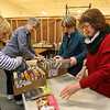 Chelmsford Friends of the Library sort donated books for the library's book sale fundraiser this weekend. From left, Betty-Mae Flaherty of North Chelmsford, and Mary Kramer, Maureen Foley and Kathy Cryan-Hicks, of Chelmford. (SUN/Julia Malakie)