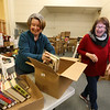 Chelmsford Friends of the Library sort donated books for the library's book sale fundraiser this weekend. Co-presidents Maureen Foley, left, and Kathy Cryan-Hicks, both of Chelmsford, and former library employees. (SUN/Julia Malakie)