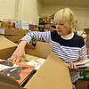 Chelmsford Friends of the Library sort donated books for the library's book sale fundraiser this weekend. Betty-Mae Flaherty of North Chelmsford.(SUN/Julia Malakie)