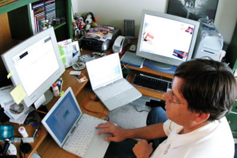 Kevin Elliott, the Mac MD, hard at work on Joe's computers