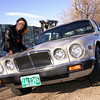 "Mary with our ""big cat"" at the coolest junkyard in Colorado"