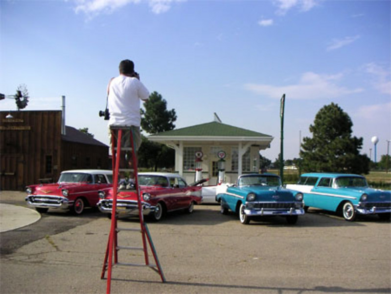 Joe up a ladder photographing Chey Heaven at the Adams County Historial Museum (photo by Joel Aragon)