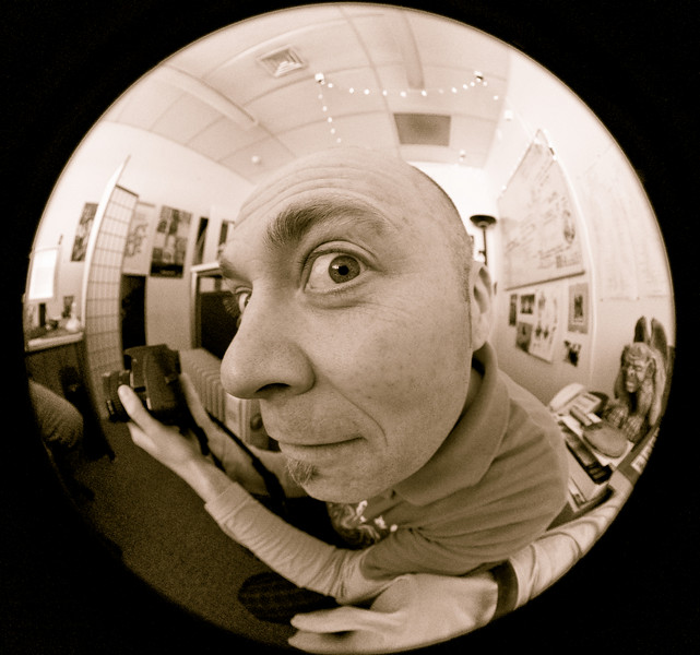 Julian in his office, He's playing with my Zenitar 16mm Fisheye, trying to decide if he needs to get one, so I snapped him with my new Sigma 8mm fisheye