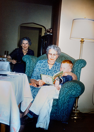 My grandmother Helen reading The Night Before Christmas to me. Her sister Margo is in the background.  The original Kodachrome slide is dated February 1961 but I suspect this was taken a month or so earlier.  Helen died when she was eighty-five and Margo lived until she was ninety-six.  Margo was an excommunicated Catholic. She married a divorced man and was probably the reason he got divorced in the first place. In those days Catholics took their doctrines seriously; they would view our modern cafeteria Catholics with contempt. Despite being thrown out of the church Margo remained a devoted Catholic. I used to irritate her by dismissing her sky fairy beliefs as primitive nonsense that would soon disappear like the belief in Greek deities disappeared.