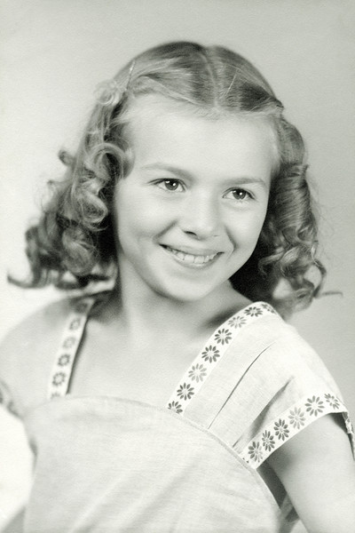 Evelyn at age eleven. This is one of the best studio portraits ever taken of my mother. The photographer captured her beautiful smile.