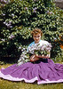 Alberta in a purple dress under lilacs. I'm guessing that Alberta had more influence on the composition of this picture than Hazel. Hazel had a just shoot and chuck approach to photography. Alberta is more deliberate and with a sharp eye for colors.
