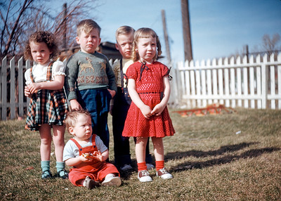 My grandmother Hazel had a knack for people pictures. This 1948 Kodachrome slide of well-dressed children is one of my favorites. I haven't saturated or altered the colors. If anything the colors here understate the vibrancy of the slide. After more than seventy years there is little if any fading: god I loved Kodachrome. I only recognize one child. The little boy standing right behind the girl with the bright red dress is Johnny Gentry. Johnnie was the son of my great aunt Elsie. I imagine some of these kids are still alive (2019). They would all be in their seventies or eighties now. This is the power of photography: it binds us to forgotten worlds.